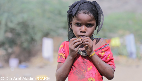 A child living in extreme poverty with little food and water