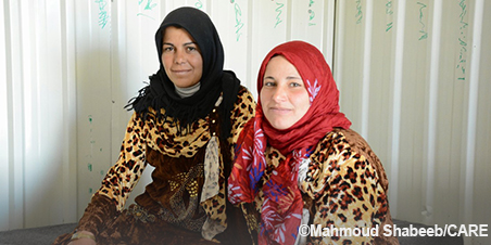 Two refugee women look at the camera