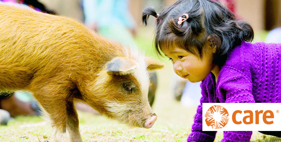 Little girl with a piglet in Bolivia