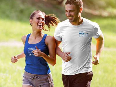 Couple running outdoors wearing a Walk the Watershed t-shirt and tank top.