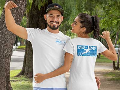 Couple wearing Walk the Watershed Tees outdoors