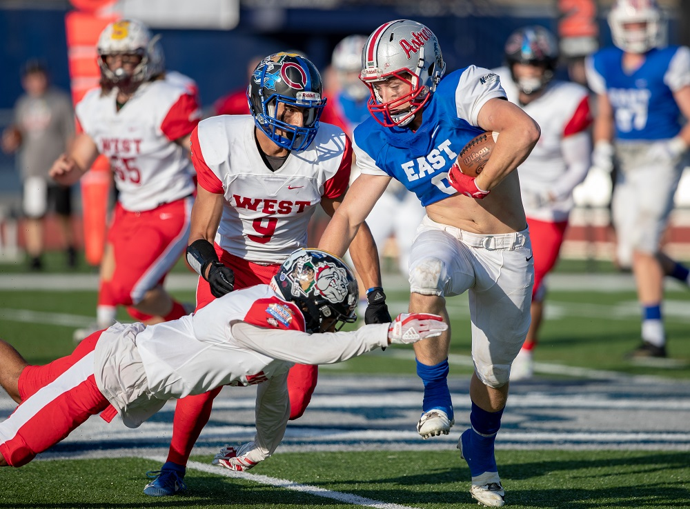 Team East running back Gannon Fast breaks a tackle during the 2019 CHaD All-Star Football Game
