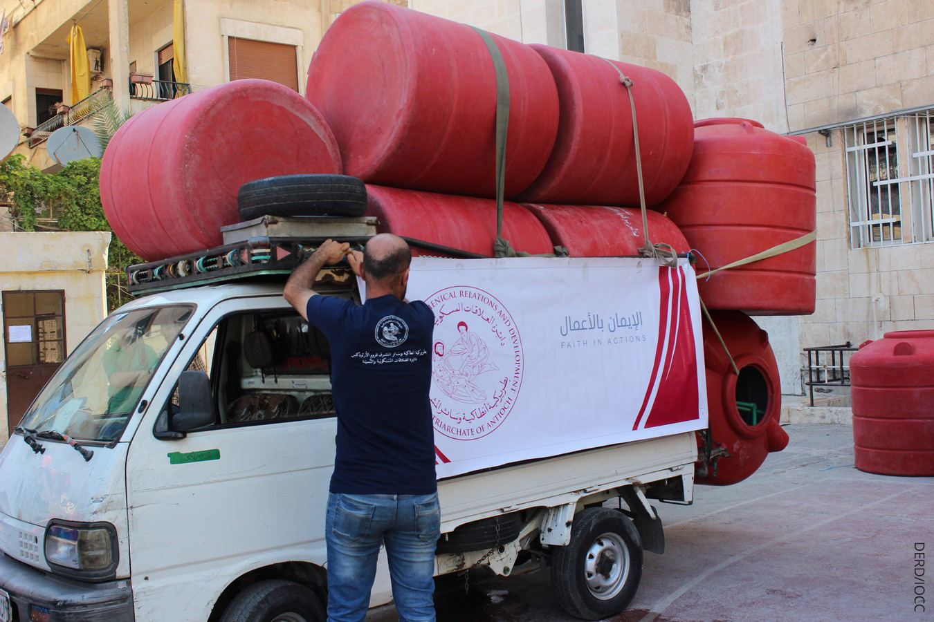 The civil war ravaging Syria has left two million people in the city of Aleppo without running water. IOCC with its Syria partner, DERD, the humanitarian arm of the Greek Orthodox Patriarchate of Antioch, is addressing the ongoing water crisis in war-torn Aleppo by delivering heavy duty water storage tanks to the homes of hundreds of displaced and affected families. photo: DERD/IOCC