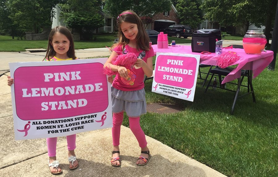 girls in front of lemonade stand