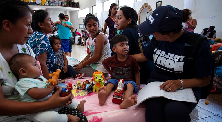 Project HOPE volunteers in a nursery