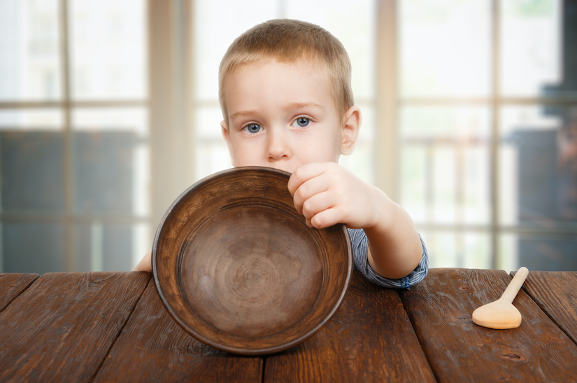 hungry boy with empty bowl