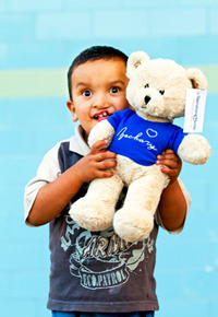 Operation Smile patient with a bear