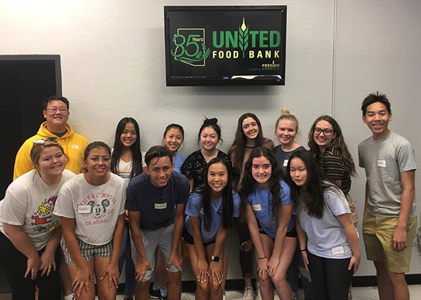 Operation Smile students volunteer at food bank