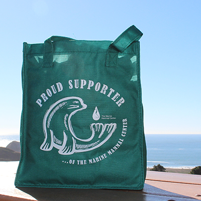 green shopping bag with sea lion design