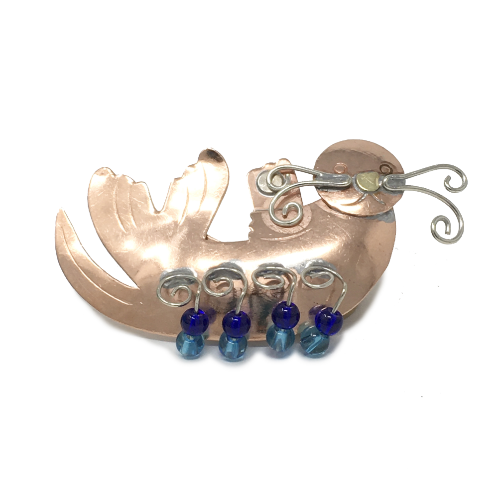 copper-colored metal sea otter pin with blue beads