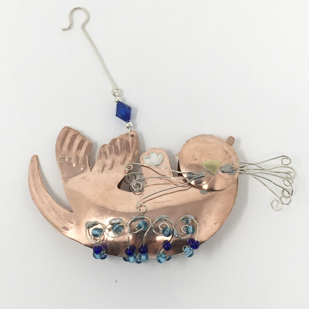 sea otter metal ornament with wire whiskers and blue beads