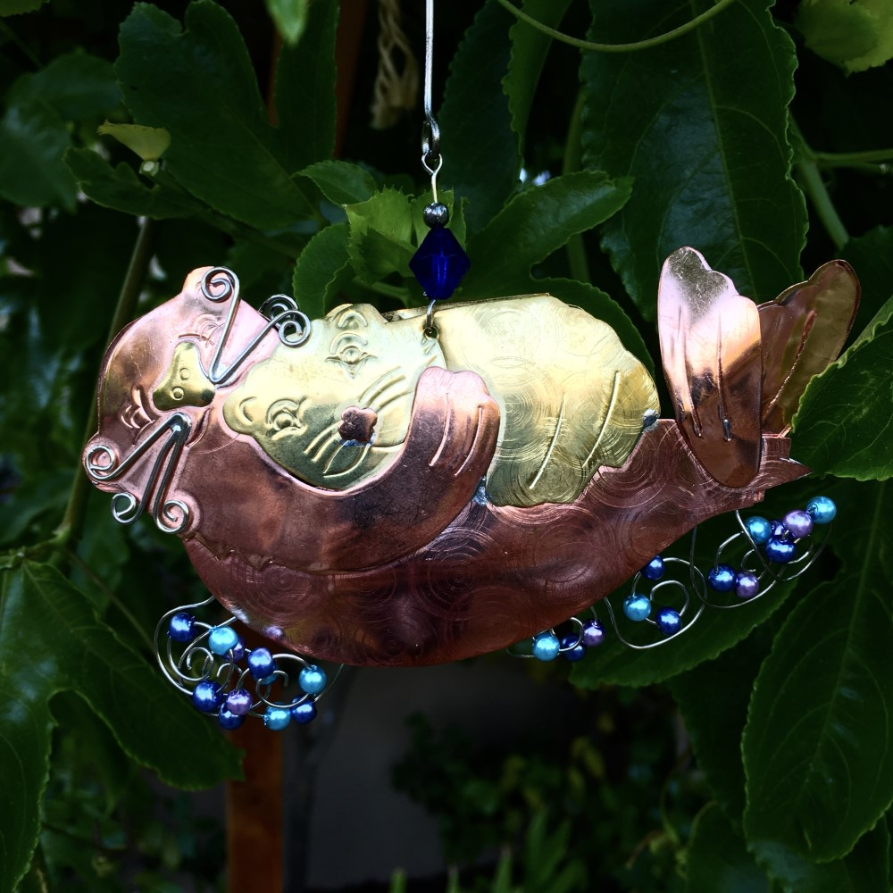 metal sea otter and pup ornament with blue and purple beads