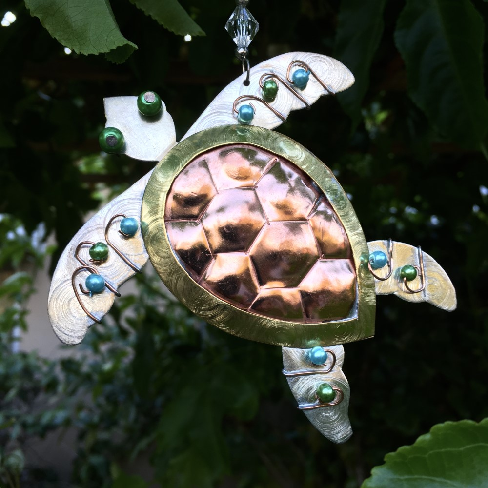 sea turtle metal ornament with blue and green beads
